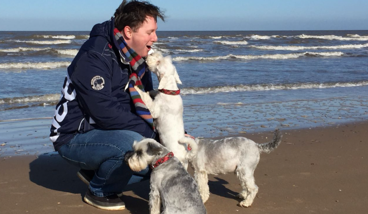 Tim Holder, Suffolk Community Foundation's Development Director with Hoagy, Ella and Louie on the beaches of Suffolk